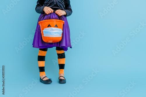 Fototapeta kid with a basket for sweets obraz
