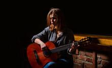Girl Play The Guitar. Woman Hi...