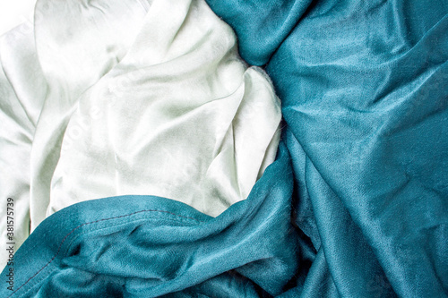Fototapeta Pastel olive and green satin fabric background. Fabric folds