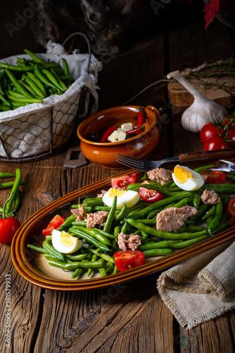 Fototapeta Rustic green bean salad with egg and tuna obraz