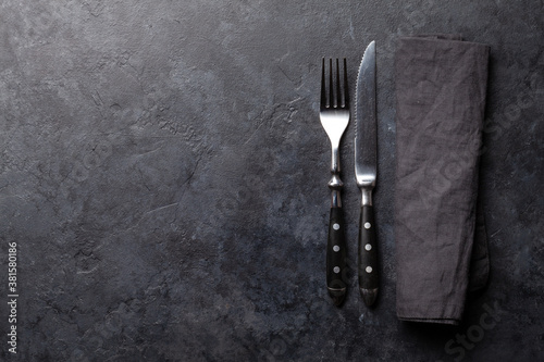 Fototapeta Stone table with knife and fork obraz