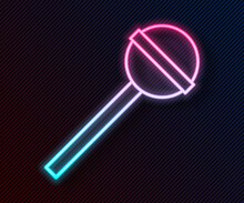 Glowing Neon Line Lollipop Icon Isolated On Black Background. Food, Delicious Symbol. Vector Illustration.