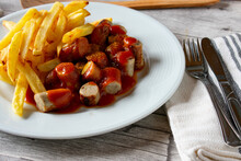 Curry Sausage With French Fries On A Plate