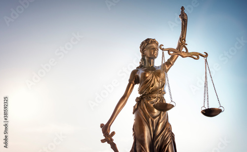 Legal law concept statue of Lady Justice with scales of justice sky background Wallpaper Mural