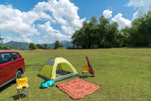 Camping Site On Grass Field Wi...