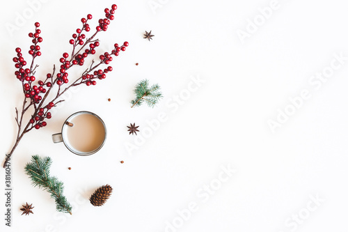 Autumn composition. Cup of coffee, fir tree branches, berries on white background. Christmas, winter concept. Flat lay, top view