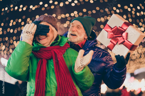 Obraz na plátne Two people old married couple lover parents celebrate x-mas christmas noel tradi