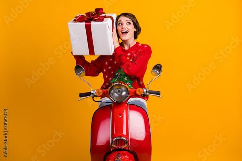 Fototapeta Photo of excited girl in christmas tree ornament sweater jumper shake big gift b