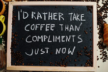 I'd Rather Take Coffee Than Compliments Just Now. Words On Blackboard Flat Lay.