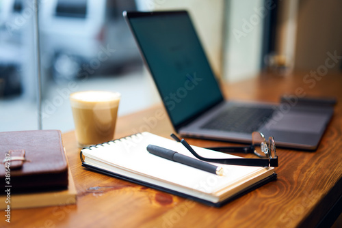 Leinwand Poster Notebook on table with pen and eyeglasses