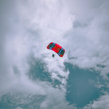 Low Angle View Of Man Skydiving Against Sky