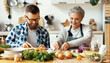 Happy mature woman with adult son cooking together at home.