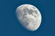canvas print picture - The Moon detailed shot in blue daylight sky, taken at 1600mm focal length, waxing gibbous phase, blue hour