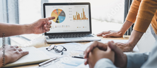 Business team collaboration discussing working analyzing with financial data and marketing growth report graph in team, presentation and brainstorming to strategy planning making profit of company