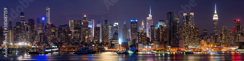 Skyscrapers of New York City, Manhattan West skyline illuminated at night. Elevated panoramic view from across the Hudson River. NYC, USA