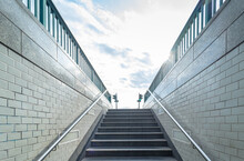 Low Angle View Of Staircase Amidst Buildings Against Sky