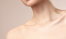Asian Women's Neck And Collarbone On A Nude Background