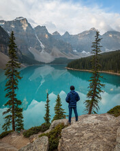A Man Standing Over The Rockpile Trail Looking Over Moraine Lake (Banff, Alberta, Canada)