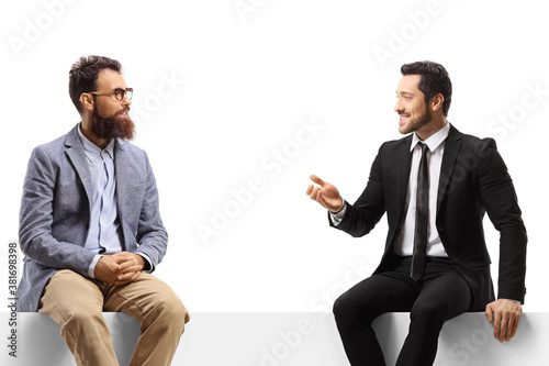 Men sitting on a panel and having a conversation Fotobehang