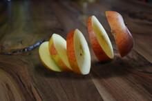 Apple Slices Levitating Above ...