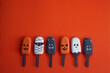 Leinwandbild Motiv Set of ice cream with halloween character face on orange background. Halloween party background