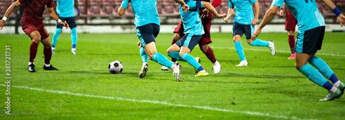 Fototapeta banner of soccer game players fighting for football
