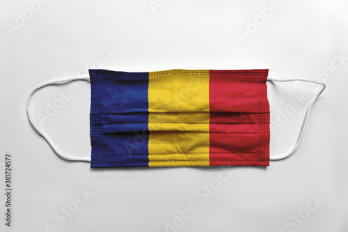 Obraz na plátně Face mask with Romania flag printed, on white background, isolated