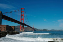 Golden Gate Bridge, San Francisco, California USA. Classic Panoramic View, Famous Landmark. Touristic Attraction, Travel Destination At Sunny Surf Beach Day, Of Blue Clear Sky. Surfing Next Fort Point