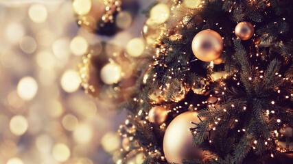 Banner dark decorated christmas tree pine on blurred background bokeh light