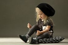 Cute Toddler Girl Learning To Tie Shoelaces
