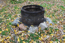 Rusty Firepit With Yellow Autu...