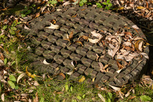 Autumn Leaves On Metal Storm Drain Access