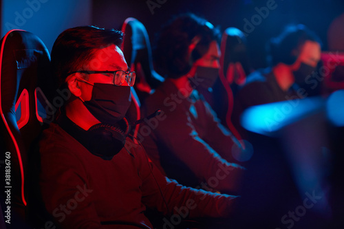 Group of computer programmers in protective masks using computers in their work Canvas Print