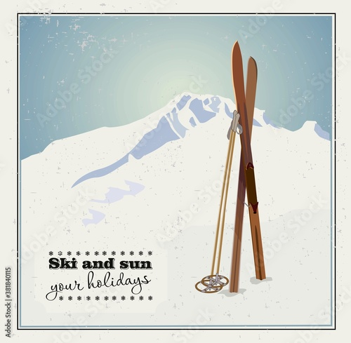 Fotografie, Obraz Vector winter themed template with wooden old fashioned skis and poles in the snow with snowy mountains and clear sky on background