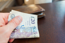 Man Paying By 20 Pound Notes At Cafe Or Shop In London