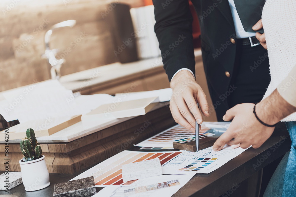 Fototapeta Manager in suit is showing different materials.