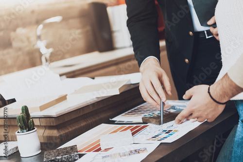 Fototapeta Manager in suit is showing different materials. obraz