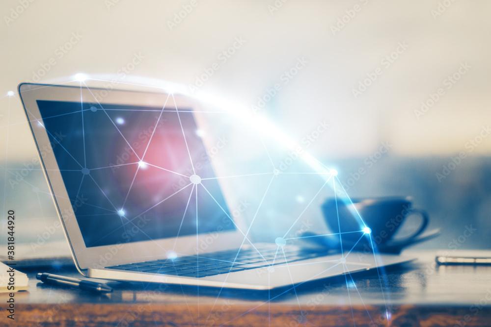 Fototapeta Computer on desktop with social network hologram. Multi exposure. Concept of international people connections.