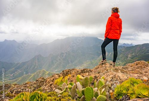 Sporty woman hiking in Anaga Mountains Taganana Tenerife, Canary island resort.
