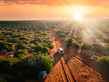 Australia, Red Sand Unpaved Road And 4x4 At Sunset, Freedom Outback