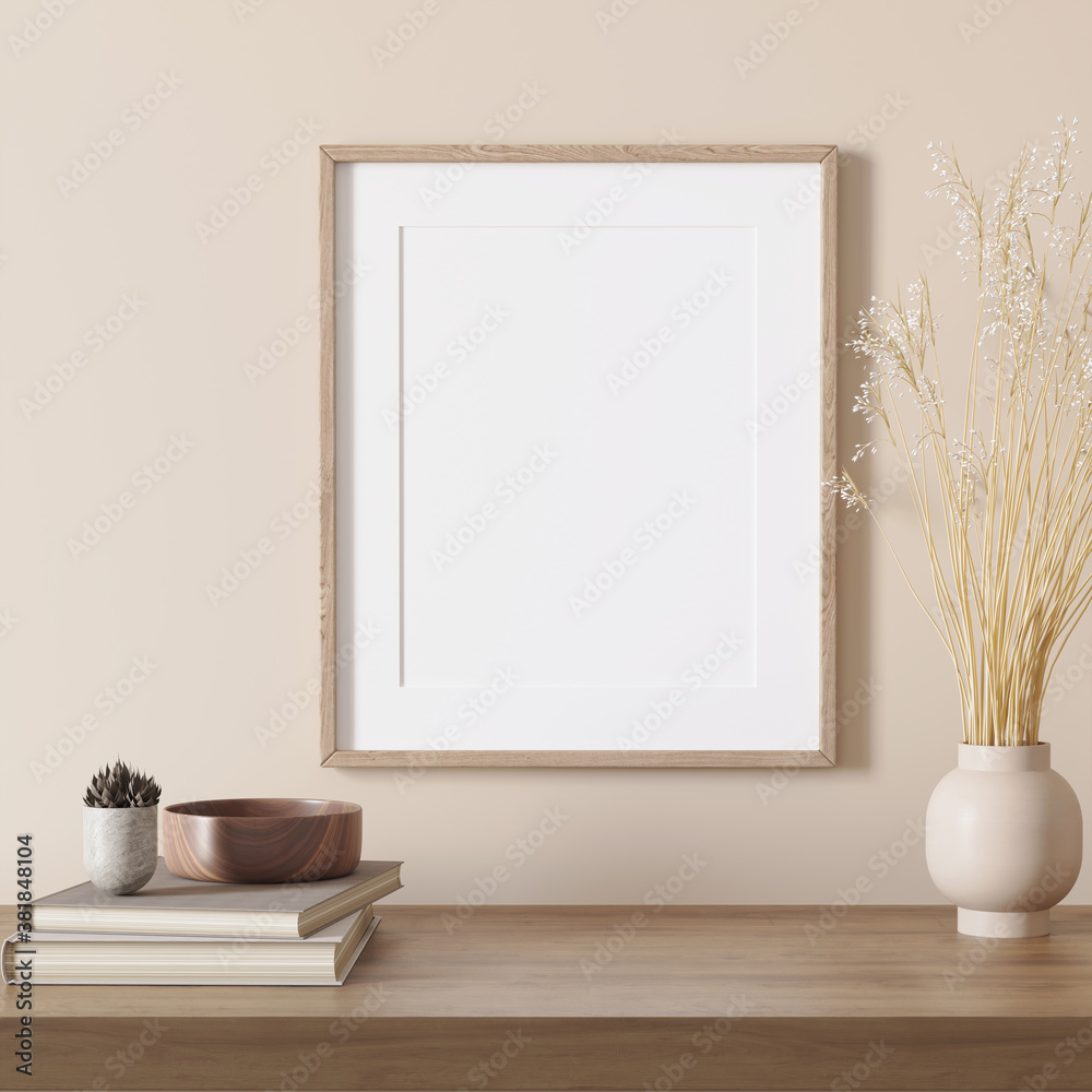 3d render of a modern beige mockup interior with wooden frame on an empty wall and a light beige vase with pampas grass, books and cactus