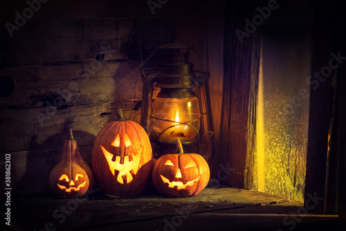 Halloween pumpkins and lantern in an old house by the window where the moonlight Fotobehang