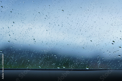 Rain drop on windscreen shot from in car during rainy day. Canvas-taulu
