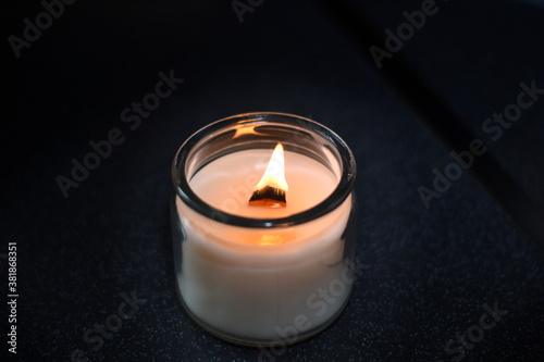 burning candles with wooden wick Wallpaper Mural