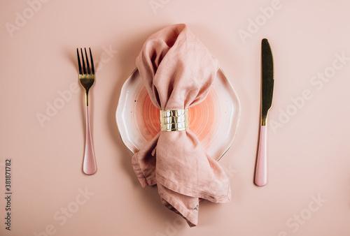 Fototapeta Pink festive table setting. Flat lay arrangement.