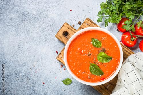 Leinwand Poster Tomato soup at white table.