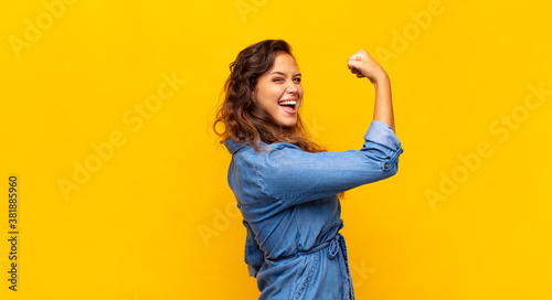 Fototapeta  feeling happy, satisfied and powerful, flexing fit and muscular biceps, looking strong after the gym obraz