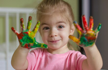 Little Cute Girl Showing Paint...