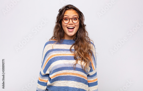 Fotografie, Obraz looking happy and pleasantly surprised, excited with a fascinated and shocked e