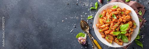 Fototapeta Fusilli pasta with tomato sauce and basil